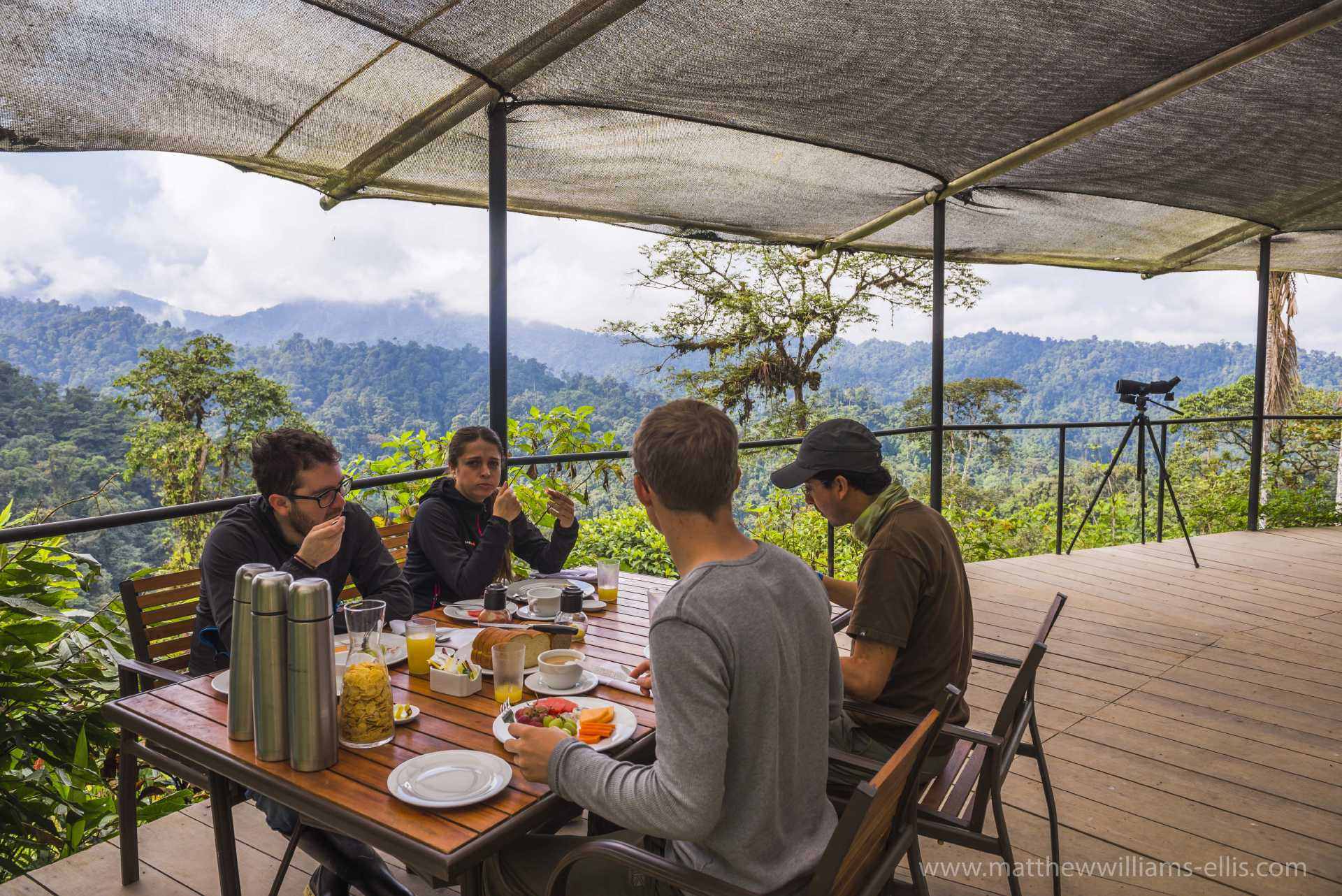 Tourist having breakfast in the jungle at the Sky Life Centre at Mashpi Cloud Forest in the Choco Rainforest, Ecuador, South America